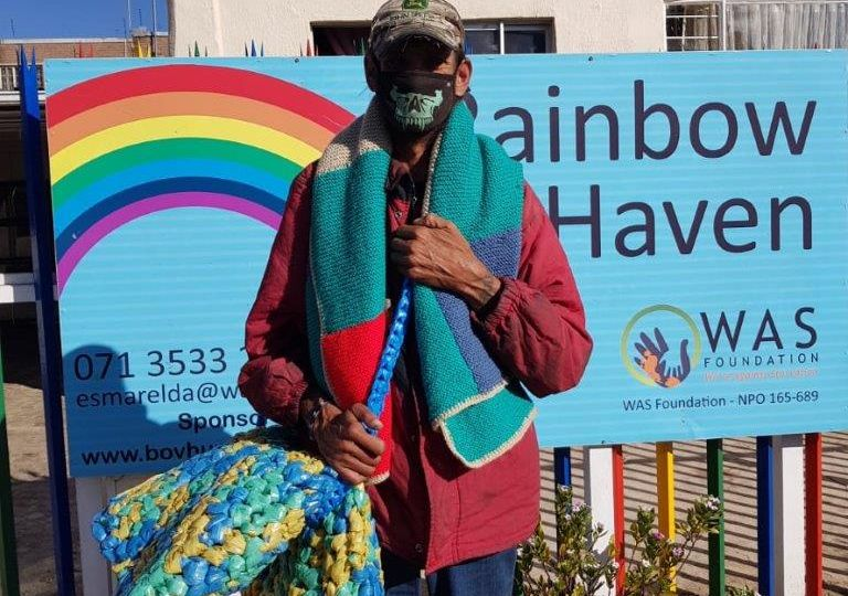 Two-of-the-people-from-the-Krugersdorp-community-who-received-a-sleeping-mat-blanket